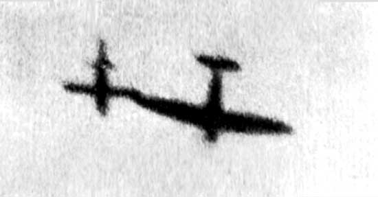 A Spitfire  using its wingtip to topple the gyros of a German  V-1 'Flying Bomb'