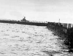 Line of bombardon creating an outer breakwater - WWII at Normandy.
