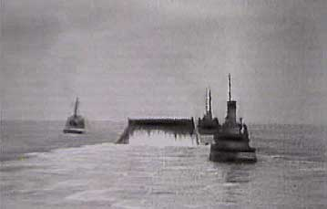Conundrum wound with HAMEL steel pipe being towed by tugs across the English Channel during Operation Pluto